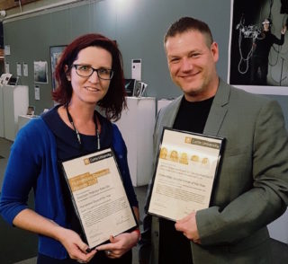 Image of Katie Ellis and Tama Leaver with awards