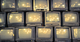 1970s televisions stacked on one another