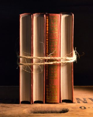 Image of four books tied together with twine