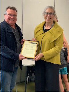 Mike Kent presenting Dawn Bennett with her Humanities Research Award 2020