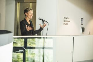Image of Helena Gaunt speaking at a microphone