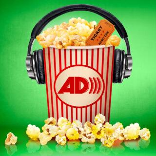 Overflowing bucket of popcorn with headphones on